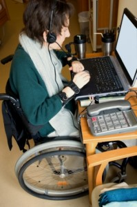 Woman with spinal cord injury working at desk